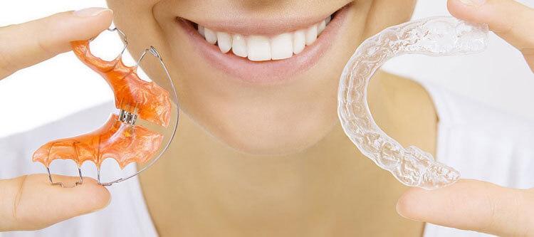 как ещё можно выровнять зубы без использования брекетов?