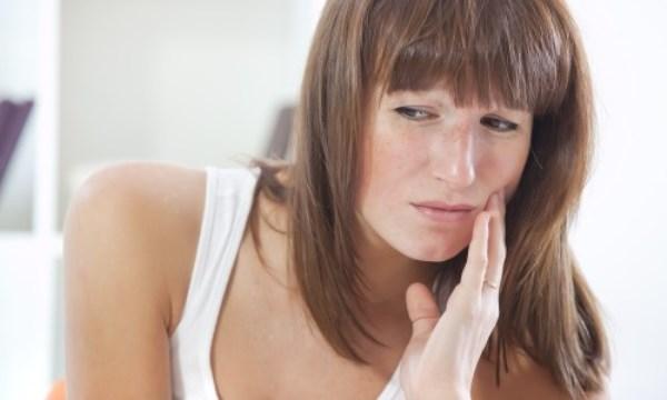 Как проявляется ретенция зуба