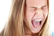 Когда появляется боль при ношении брекетов